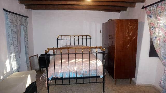 Dormitorio de la casa en la sierra de Aracena